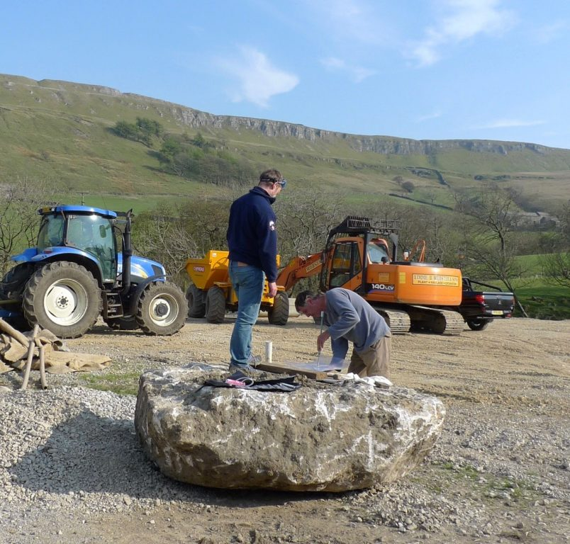 1481541086_Steve Woods and Hucky preparing to break up a huge rock unearthed whilst building a new barn, Kidstones Farm, Bishopdale. Photo Phil Ryder.jpg